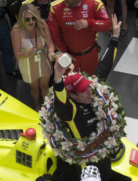 Simon Pagenaud, Team Penske Chevrolet, pours milk over his head in victory lane