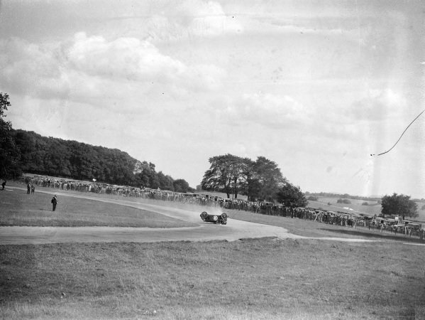 A. H. Langley, MG, rolls his car at Starkey's corner.