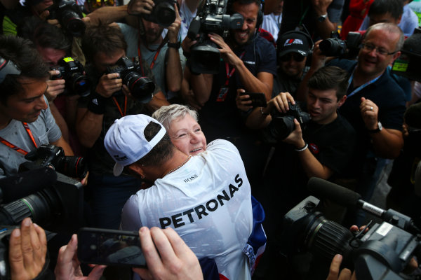 Autodromo Hermanos Rodriguez, Mexico City, Mexico. Sunday 29 October 2017. Lewis Hamilton, Mercedes AMG, celebrates with his mum Carmen Larbalestier, surrounded by photographers and media,after securing his 4th world drivers championship title, and third with Mercedes. World Copyright: Charles Coates/LAT Images  ref: Digital Image DJ5R7922