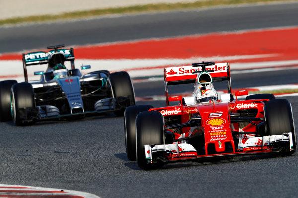 Circuit de Catalunya, Barcelona, Spain Tuesday 23 February 2016. Sebastian Vettel, Ferrari SF16-H, and Nico Rosberg, Mercedes F1 W07 Hybrid. World Copyright: Steven Tee/LAT Photographic ref: Digital Image _H7I2103