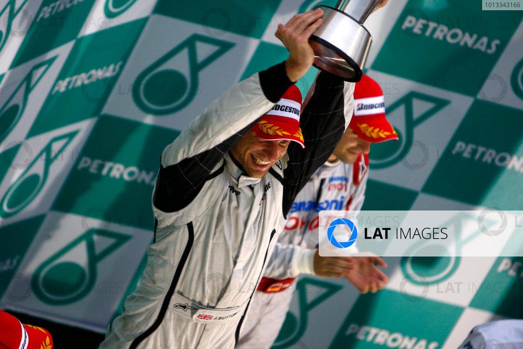 Sepang, Kuala Lumpur, Malaysia5th April 2009Jenson Button, Brawn GP BGP001 Mercedes lifts the trophy on the podium.World Copyright: Steven Tee/LAT Photographicref: Digital Image _95U0145