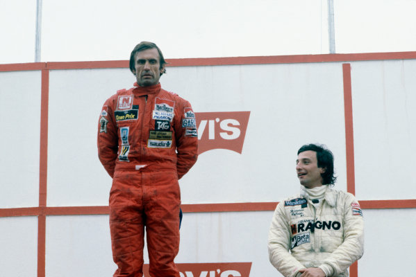 Jacarepagua, Rio de Janeiro, Brazil. 27-29 March 1981. Carlos Reutemann (Williams FW07C-Ford Cosworth), 1st position, and Riccardo Patrese (Arrows A3-Ford Cosworth), 3rd position, on the podium. Portrait. Ref: 81 BRA 09. World Copyright: LAT Photographic
