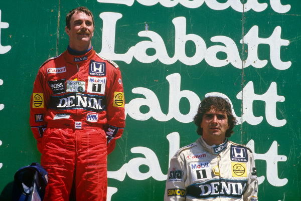 Montreal, Quebec, Canada. 13-15 June 1986. Nigel Mansell, 1st position, and Nelson Piquet, 2nd position (both Williams Honda) on the podium. Portrait. Ref: 86 CAN 08. World Copyright - LAT Photographic