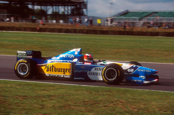 Silverstone, England.14-16 July 1995.Michael Schumacher (Benetton B195 Renault). He exited the race after having a collision with Hill on lap 46.Ref-95 GB 31.World Copyright - LAT Photographic
