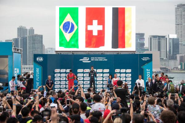 2016/2017 FIA Formula E Championship. Hong Kong ePrix, Hong Kong, China. Sunday 9 October 2016. Lucas Di Grassi (BRA), ABT Schaeffler Audi Sport, Spark-Abt Sportsline, ABT Schaeffler FE02, Sebastien Buemi (SUI), Renault e.Dams, Spark-Renault, Renault Z.E 16 and Nick Heidfeld (GER), Mahindra Racing, Spark-Mahindra, Mahindra M3ELECTRO on the podium. Photo: Andrew Ferraro/LAT/Formula E ref: Digital Image _FER2404