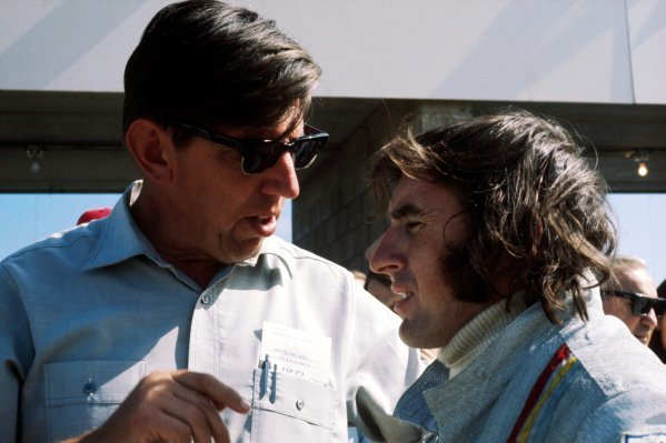 (L to R): Ken Tyrrell (GBR) Tyrrell Team Owner talks with pole sitter Jackie Stewart (GBR) Tyrrell, who finished the race in fifth position. United States Grand Prix, Rd 11, Watkins Glen, USA, 3 October 1971.