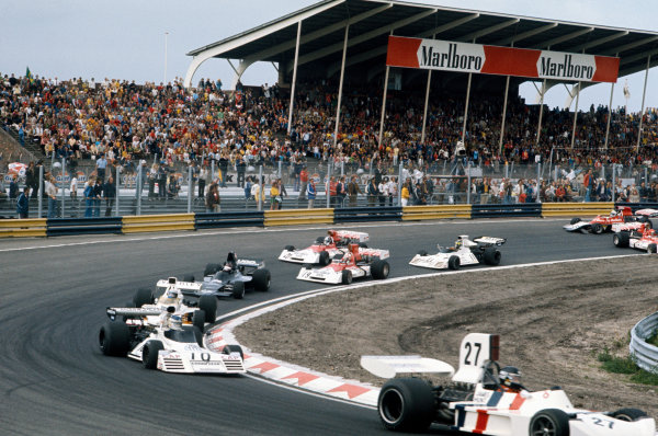 Zandvoort, Holland. 27th - 29th July 1973.James Hunt (March 731-Ford), 3rd position, leads Carlos Reutemann ( Brabham BT42-Ford), retired, Denny Hulme (McLaren M23-Ford), retired, Jackie Oliver (Shadow DN1A-Ford), retired, and Clay Regazzoni (B.R M. P160E), 8th position, at the start, action. World Copyright: LAT Photographic.Ref:  73HOL75.