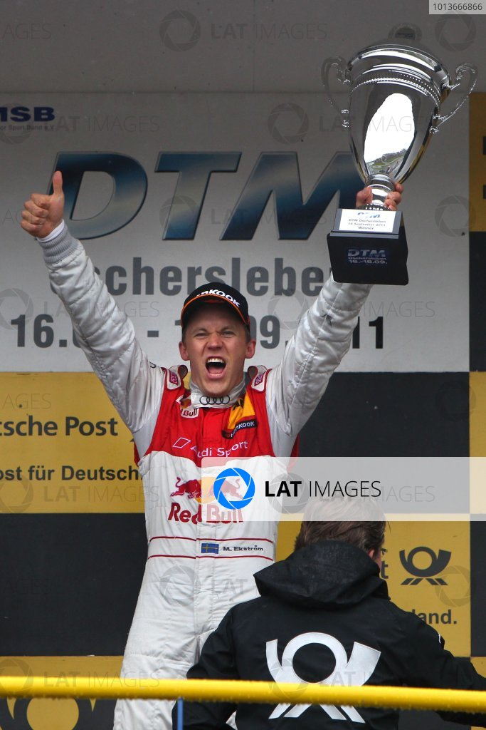 Race winner Mattias Ekstrom (SWE), Audi Sport Team Abt Sportsline, Red Bull Audi A4 DTM (2009) celebrates on the podium.DTM, Rd8, Oschersleben, Germany, 16-18 September 2011 Ref: Digital Image dne1118se512