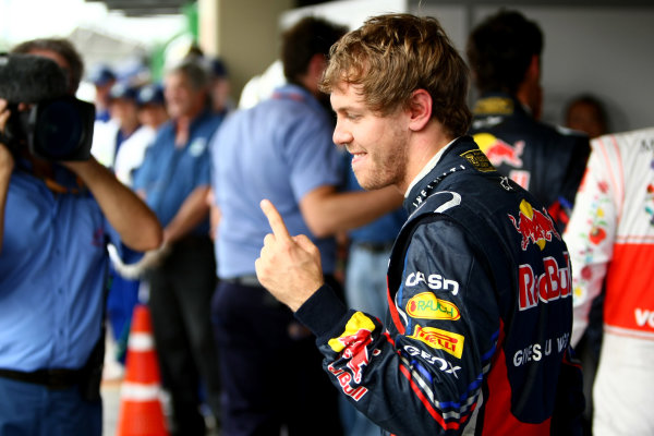 Interlagos, Sao Paulo, Brazil26th November 2011Sebastian Vettel, Red Bull Racing RB7 Renault, celebrates pole. Portrait. World Copyright: Andy Hone/LAT Photographicref: Digital Image CSP29789