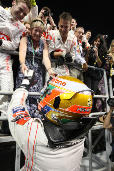 Race winner Lewis Hamilton (GBR) McLaren celebrates with his mother Carmen Lockhart (GBR).