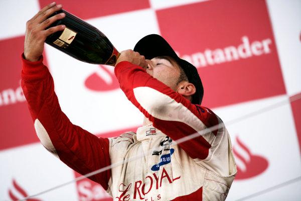 Round 4.Silverstone, England. 11th July 2010. Sunday Race. Daniel Morad, (CAN, Status Grand Prix) celebrates victory on the podium.Portrait. World Copyright: Drew Gibson/GP3 Media Service.  Digital Image _Y8P1392
