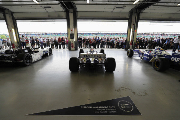 Williams 40 Event Silverstone, Northants, UK Friday 2 June 2017. Fans view a garage containing the 1999 BMW Le Mans winner and classic Williams F1 cars. World Copyright: Zak Mauger/LAT Images ref: Digital Image _56I0130