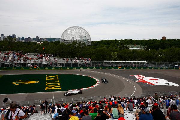Circuit Gilles Villeneuve, Montreal, Canada. Friday 9 June 2017. Lance Stroll, Williams FW40 Mercedes, leads Lewis Hamilton, Mercedes F1 W08 EQ Power+. World Copyright: Andrew Hone/LAT Images ref: Digital Image _ONZ0100
