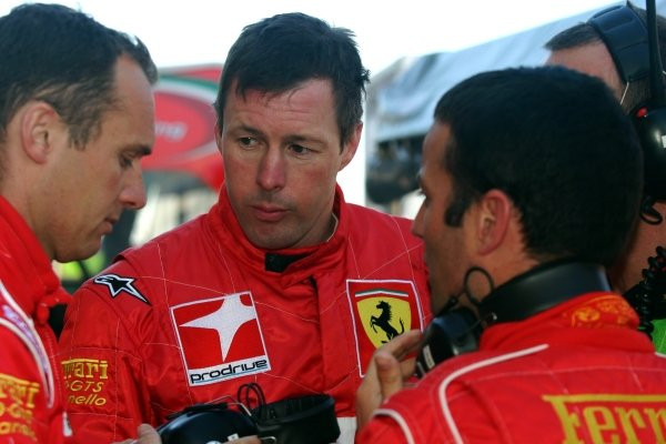 L-R: Prodrive drivers Rickard Rydell (SWE), Colin McRae (GBR) and Darren Turner (GBR) discuss tactics during warm-up.