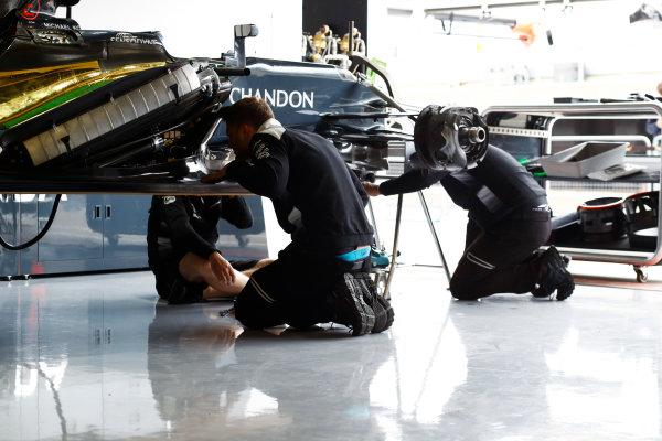 Silverstone, Northamptonshire, UK Thursday 7 July 2016. McLaren mechanics at work on a McLaren MP4-31 Honda.  World Copyright: Tee/LAT Photographic ref: Digital Image _H7I4302