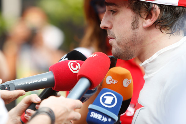 2012 Indian Grand Prix - Saturday Buddh International Circuit, New Delhi, India. 27th October 2012. Fernando Alonso, Ferrari, is interviewed after qualifying. World Copyright:Glenn Dunbar/LAT Photographic ref: Digital Image _89P6547