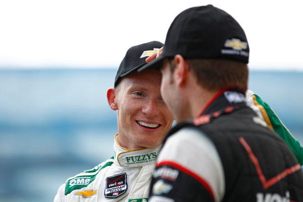 11-13 April, 2014, Long Beach, California USA Mike Conway and Will Power celebrate on the podium ©2014, Phillip Abbott LAT Photo USA