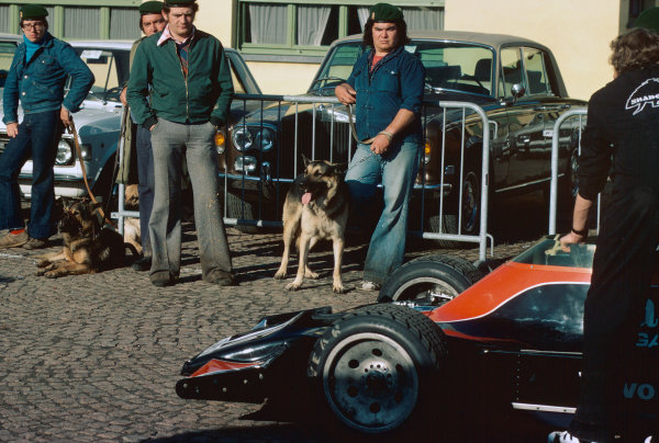 Monza, Italy. 10th - 12th September 1976. Tom Pryce (Shadow DN8A-Ford), 8th position, paraded through the paddock infront of the Police and guard dogs, atmosphere. World Copyright: LAT Photographic. Ref: 76 ITA 24.