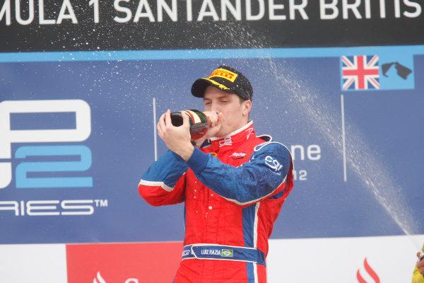 Silverstone, Northamptonshire, England. 8th July 2012. Sunday Race. Luiz Razia (BRA, Arden International) celebrates his victory on the podium. Photo: Photo: Alastair Staley/GP2 Media Service./GP2 Media Service. Ref: Digital Image _O9T8873.jpg