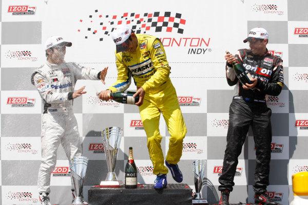 20-22 July, 2012, Edmonton, Alberta CAHelio Castroneves, Takuma Sato and Will Power celebrate with champagne on the podium.(c)2012, Phillip AbbottLAT Photo USA
