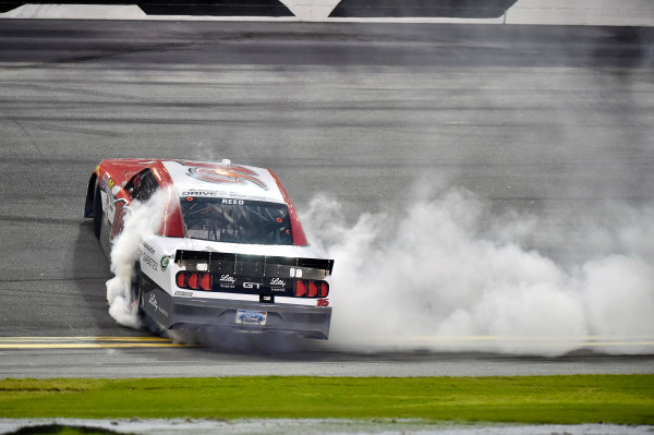 20-21 February, 2015, Daytona Beach, Florida USA Ryan Reed celebrates his win with a burnout ? 2015, Nigel Kinrade LAT Photo USA