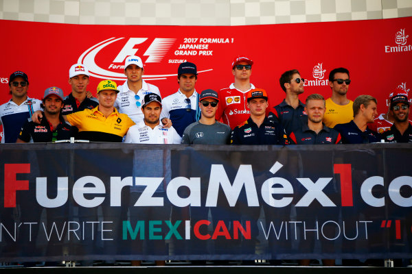 Suzuka Circuit, Japan. Sunday 08 October 2017. Sergio Perez, Force India, and the rest of the drivers take part in an event in support of Mexico on the podium. World Copyright: Andy Hone/LAT Images  ref: Digital Image _ONY8372