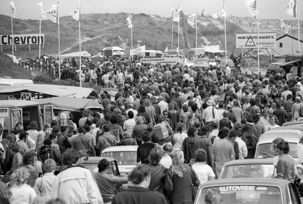 The crowd pour into the circuit before the start of the race.