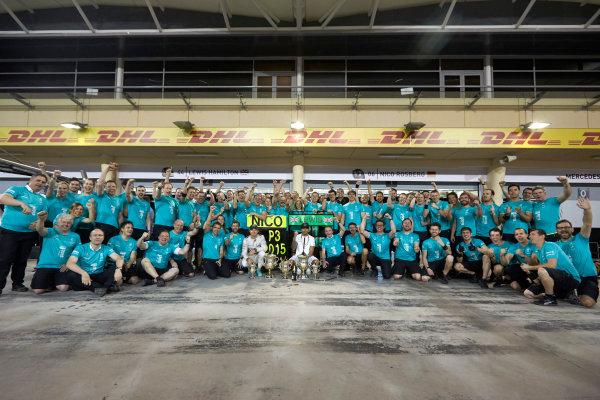 Bahrain International Circuit, Sakhir, Bahrain. Sunday 19 April 2015. Lewis Hamilton, Mercedes AMG, 1st Position, Nico Rosberg, Mercedes AMG, 3rd Position, and the Mercedes team celebrate victory. World Copyright: Steve Etherington/LAT Photographic. ref: Digital Image SNE24566