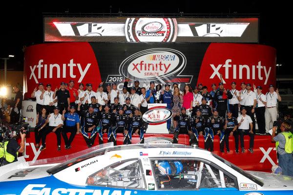 20-21 November, 2015, Homestead, Florida USA Chris Buescher with the Xfinity Series Championship trophy ? 2015, Nigel Kinrade LAT Photo USA
