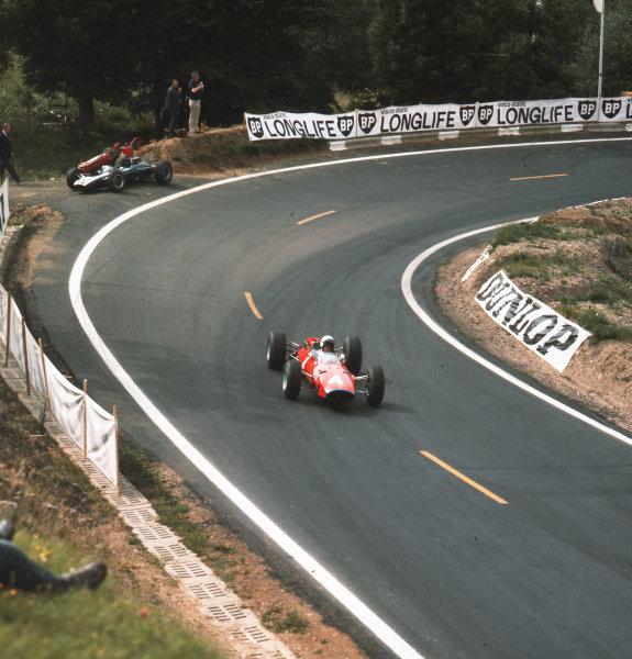 Charade, Clermont-Ferrand, France.25-27 June 1965.Lorenzo Bandini (Ferrari 1512) passes the retired Cooper T77 Climax of Jochen Rindt.Ref-3/1763.World Copyright - LAT Photographic