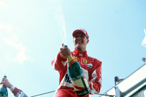2005 Hungarian Grand Prix. Hungaroring, Hungary. 29th - 31st July 2005 Michael Schumacher, Ferrari F2005 celebrates his second position on the podium. World Copyright: Charles Coates/LAT Photographic Ref: 35mm Image A10