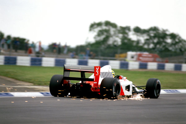 1991 British Grand Prix.Silverstone, England. 12-14 July 1991.Ayrton Senna (McLaren MP4/6 Honda) sends the sparks flying before retiring out of fuel.Ref-91 GB 31.World Copyright - LAT Photographic