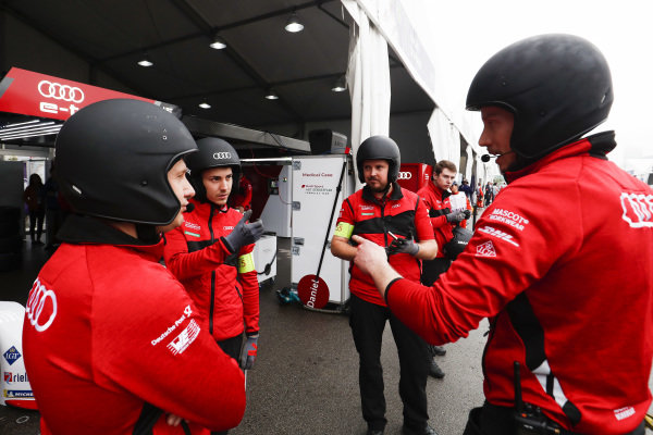 The Audi Sport ABT Schaeffler team chat in the pit lane