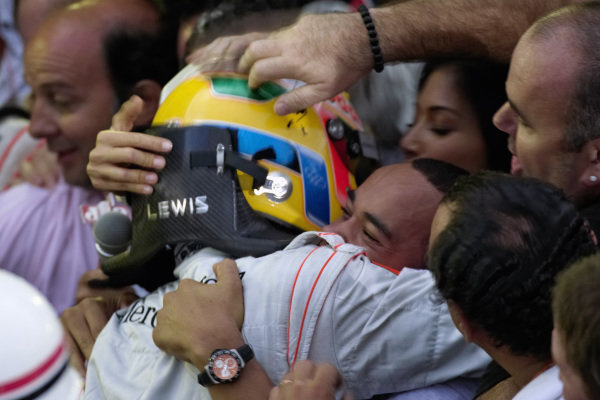 New World Champion Lewis Hamilton is congratulated by the crowd, including brother Nicolas.