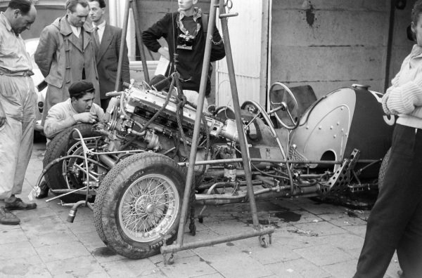 The engine is lowered into Juan Manuel Fangio's Maserati A6GCM-53.