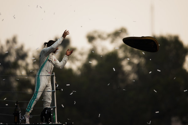 Lewis Hamilton, Mercedes AMG F1, 1st position, throws a Sombrero hat into the crowd from the podium