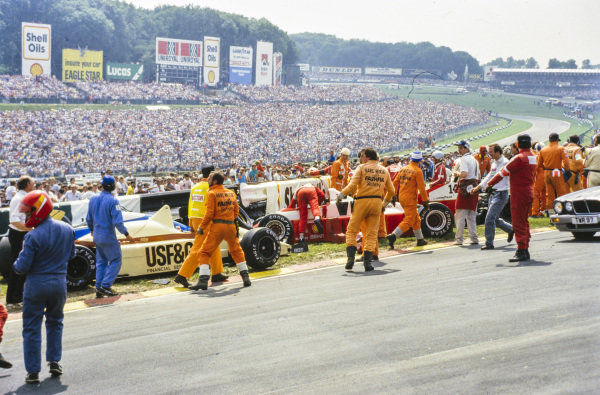 The aftermath of a collision involving Christian Danner, Arrows A8 BMW, Jonathan Palmer, Zakspeed 861, and Thierry Boutsen, Arrows A8 BMW. Jacques Laffite, Ligier, sustained leg and ankle injuries.