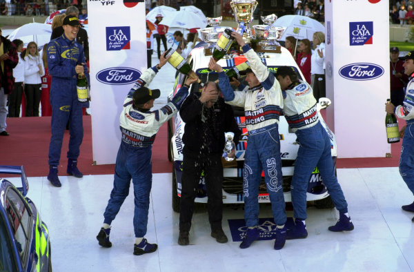 2001 World Rally Championship. ArgentinaMay 3rd-6th, 2001John Millington (M Sport logistics manager) receives his share of the champagne from his appreciative drivers.Photo: Ralph Hardwick/LAT