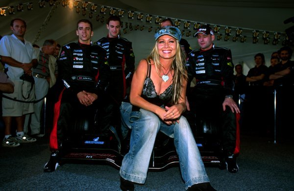 Model Sarah Jane (AUS) helped the Minardi team launch their new PS03. Drivers (L to R): Justin Wilson (GBR) Minardi, test driver Matteo Bobbi (ITA) and Jos Verstappen (NED) Minardi enjoyed the view. 