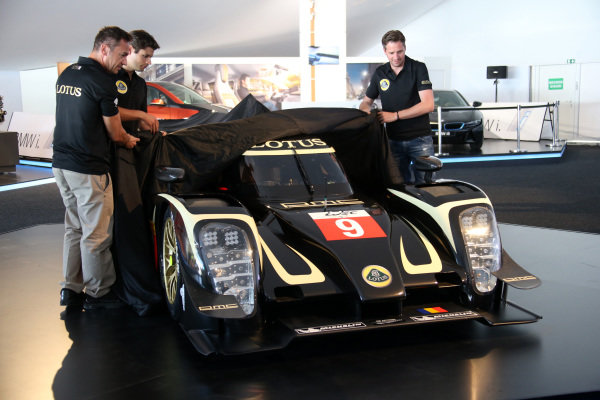 Official unveiling of the all new Lotus T129 LMP1 prototype car at the Innovation Centre. The Kodewa Racing Team are now hopeful of having the car ready for the fifth round of the WEC: the 6 Hours of Circuit of the Americas in Austin, Texas on 20 September 2014. Lotus LMP Team including drivers Christijan Albers (NED), right, Christophe Bouchut (FRA), left, and Pierre Kaffer (GER), centre.  24 Heures du Mans, Le Mans, France, 12 June 2014.