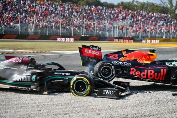 Sir Lewis Hamilton, Mercedes W12 and Max Verstappen, Red Bull Racing RB16B collide at the first chicane. Sir Lewis Hamilton, Mercedes, tries to extract himself from the gravel trap