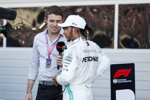 Race winner Lewis Hamilton, Mercedes AMG F1, celebrates in parc ferme and talks to Paul di Resta