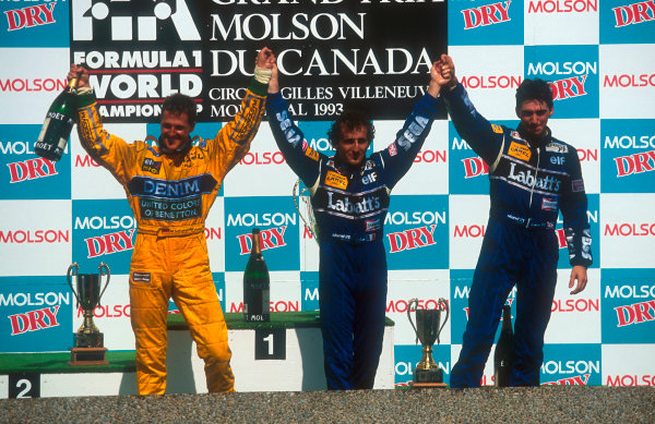 1993 Canadian Grand Prix.Montreal, Canada.11-13 June 1993.Alain Prost (Williams Renault), 1st position, Michael Schumacher (Benetton Ford) 2nd position and Damon Hill (Williams Renault) 3rd position on the podium.Ref-93 CAN 01.World Copyright - LAT Photographic