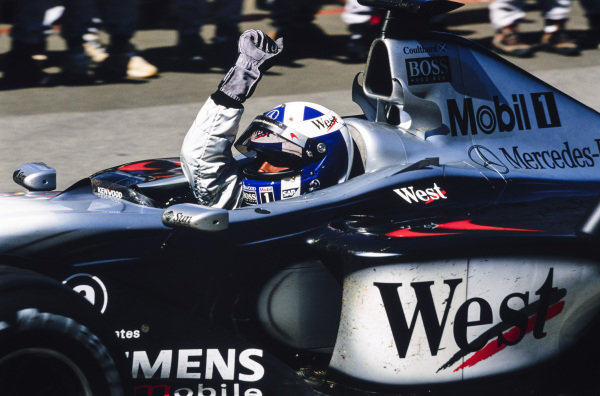 David Coulthard, McLaren MP4-16 Mercedes, celebrates victory.