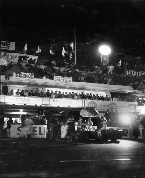 Le Mans, France. 18th - 19th June 1966. Pedro Rodriguez/Richie Ginther (Ferrari 330P3 Spyder), retired, pit stop and driver change at night, action. World Copyright: LAT Photographic.Ref: B/WPRINT.