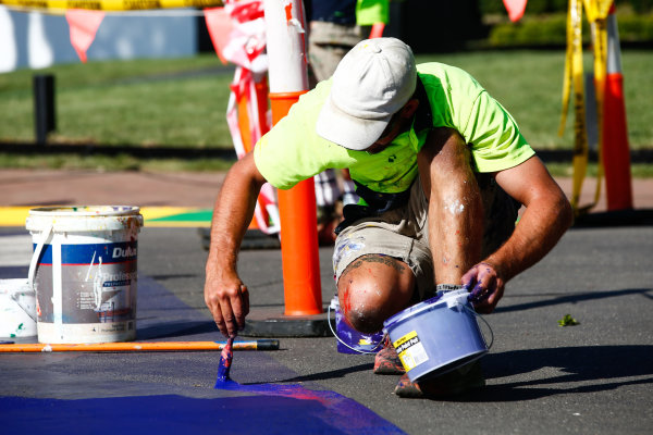 Touching up the paint on the track.