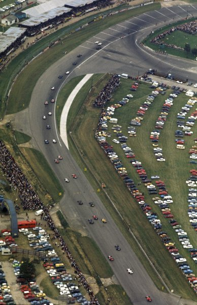 An aerial view of the field heading around Woodcote and taking their grid positions for the start of the race. British Grand Prix, Silverstone, 14 July 1973. BEST IMAGE
