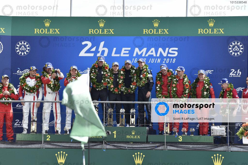 #77 Proton Competition Porsche 911 RSR: Christian Ried, Julien Andlauer, Matt Campbell, #54 Spirit of Race Ferrari 488 GTE: Thomas Flohr, Francesco Castellacci, Giancarlo Fisichella, #85 Keating Motorsports Ferrari 488 GTE: Ben Keating, Jeroen Bleekemolen, Luca Stolz celebrate on the podium