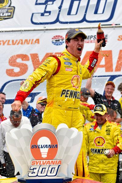 19-21 September, 2014, Loudon, New Hampshire USA Joey Logano celebrates his win in Victory Lane ?2014, Nigel Kinrade LAT Photo USA