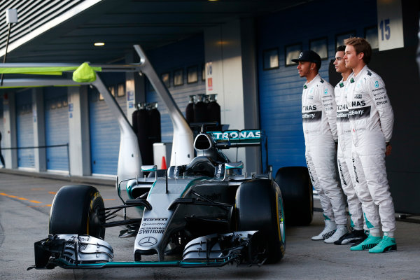 2015 F1 Pre Season Test 1 - Day 1 Circuito de Jerez, Jerez, Spain. Sunday 1 February 2015. Lewis Hamilton, Mercedes AMG, Nico Rosberg, Mercedes AMG, and Pascal Wehrlein, Mercedes AMG, launch the Mercedes W06. World Copyright: Alastair Staley/LAT Photographic. ref: Digital Image _R6T3061